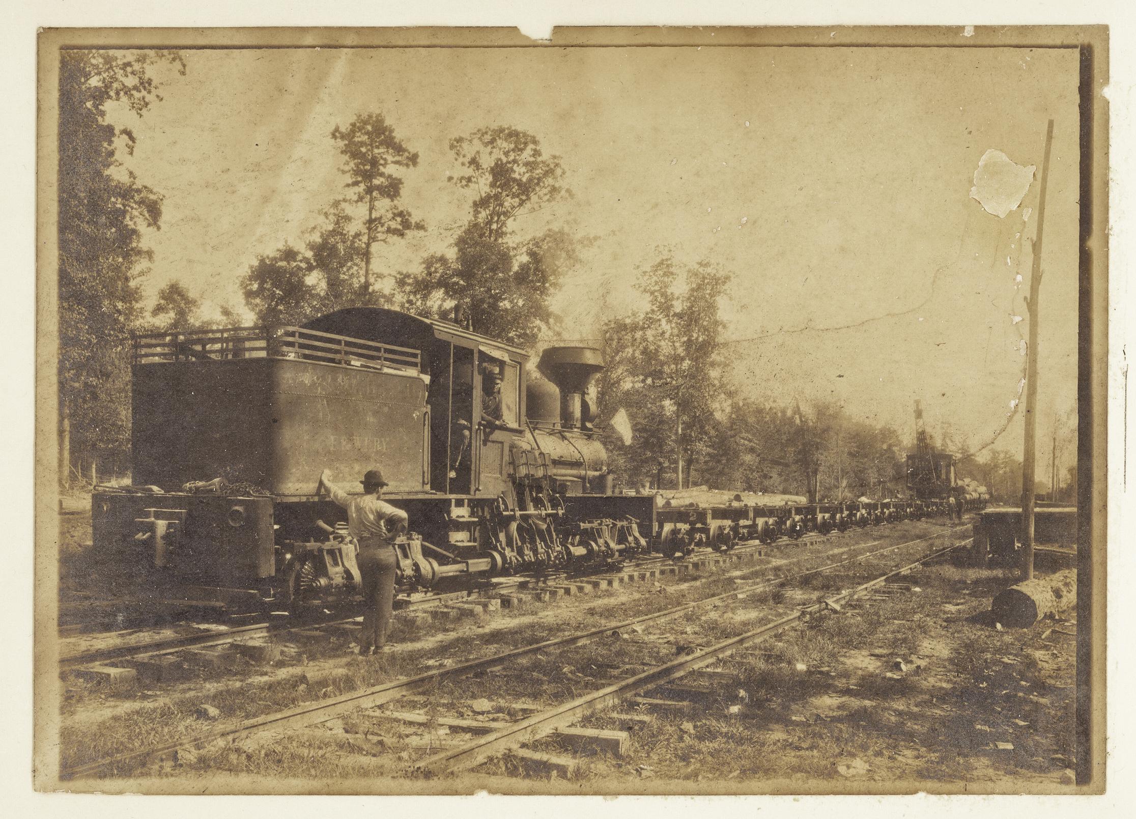 Train & Skidder on East & West Louisiana Ry. (1903)