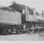Unidentified man and boy in North Louisiana & Gulf Railroad Locomotive, circa 1909