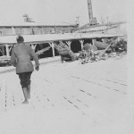 Unidentified woman at Hodge sawmill in the snow.