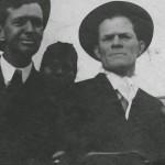 O.E. Hodge (left) and J.S. Hunt (right), near Hodge, La., circa 1915. (unidentified person in background)