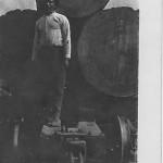 Unidentified man, with virgin pine logs, Hodge, La. circa 1909.